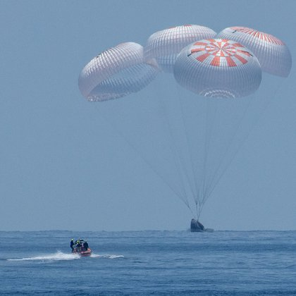 The SpaceX Crew Dragon Endeavour spacecraft is seen as it lands with NASA astronauts Robert Behnken and Douglas Hurley onboard in the Gulf of Mexico off the coast of Pensacola, Florida, U.S., August 2, 2020. NASA/Bill Ingalls/Handout via REUTERS  THIS IMAGE HAS BEEN SUPPLIED BY A THIRD PARTY.