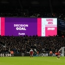 Soccer Football - Premier League - West Ham United v Arsenal - London Stadium, London, Britain - December 9, 2019 The big screen displays a VAR review message after West Ham United's Angelo Ogbonna scores their first goal REUTERS/David Klein EDITORIAL USE ONLY. No use with unauthorized audio, video, data, fixture lists, club/league logos or