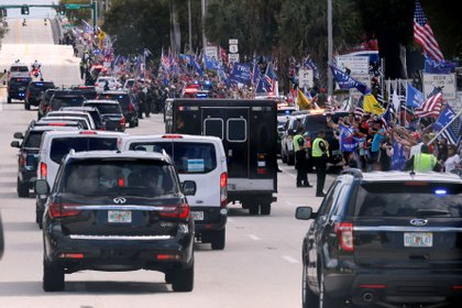 Supporters of Donald Trump as they arrive at the Mar-a-Lago residence in Palm Beach, Florida.