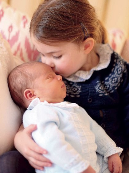 Princess Charlotte kisses her brother Prince Louise.  Photo taken by Kate Middleton.