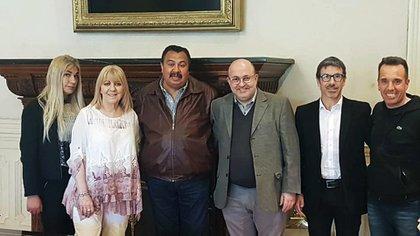 Vestida de blanco, Susana Martinengo, la ex directora del +area Documentación Presidencial, en una foto en la Casa Rosada