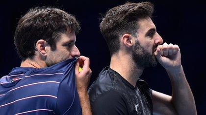 Zeballos y Granollers debieron retirarse de su partido de este viernes por una lesión del español (Photo by Glyn KIRK / AFP)