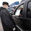 A driver shows his papers while being stopped at a checkpoint as the spread of the coronavirus disease (COVID-19) continues,in Buenos Aires, Argentina April 1, 2020. REUTERS/Agustin Marcarian