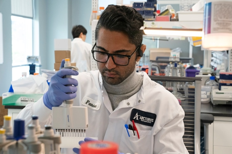 Research assistant Parsa Parirokh, of RNA medicines company Arcturus Therapeutics, conducts research on a vaccine for the novel coronavirus (COVID-19) at a laboratory in San Diego, California, U.S., March 17, 2020. REUTERS/Bing Guan
