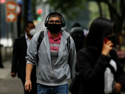 People walk on the street, as the coronavirus disease (COVID-19) outbreak continues, in Mexico City, Mexico September 21, 2020. REUTERS/Carlos Jasso