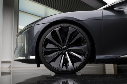 The front wheel of a Lucid Air prototype electric vehicle, manufactured by Lucid Motors Inc., is displayed at the company's headquarters in Newark, California, U.S., on Monday, Aug. 3, 2020. The final specs and design of the Lucid Air are due to be unveiled at an event in September and executives say customers can now expect delivery of the first batch of Airs in spring 2021. Photographer: David Paul Morris/Bloomberg