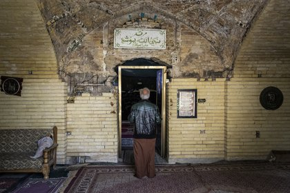 A man enters the shrine of the biblical prophet Joshua in Baghdad on January 29, 2021. (Ivor Prickett / The New York Times).