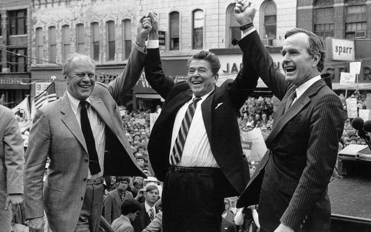 Gerald Ford, Ronald Reagan y George H.W. Bush. (AP Photo, File)