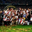 Soccer Football - Copa Libertadores Final - Second Leg - River Plate v Boca Juniors - Santiago Bernabeu, Madrid, Spain - December 9, 2018 River Plate players celebrate with the trophy after winning the Copa Libertadores final REUTERS/Juan Medina