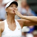 FILE PHOTO: Maria Sharapova of Russia celebrates after defeating Sabine Lisicki of Germany in their semi-final match at the Wimbledon tennis championships in London June 30, 2011. REUTERS/Eddie Keogh/File Photo