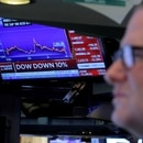 Traders on the floor of the New York Stock Exchange (NYSE) after the close of trading New York, U.S., March 12, 2020. REUTERS/Brendan McDermid TPX IMAGES OF THE DAY