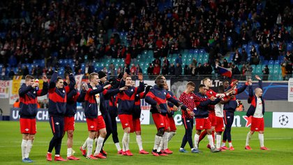 Soccer Football - Champions League - Round of 16 Second Leg - RB Leipzig v Tottenham Hotspur - Red Bull Arena, Leipzig, Germany - March 10, 2020  RB Leipzig players celebrate after the match   Action Images via Reuters/Matthew Childs