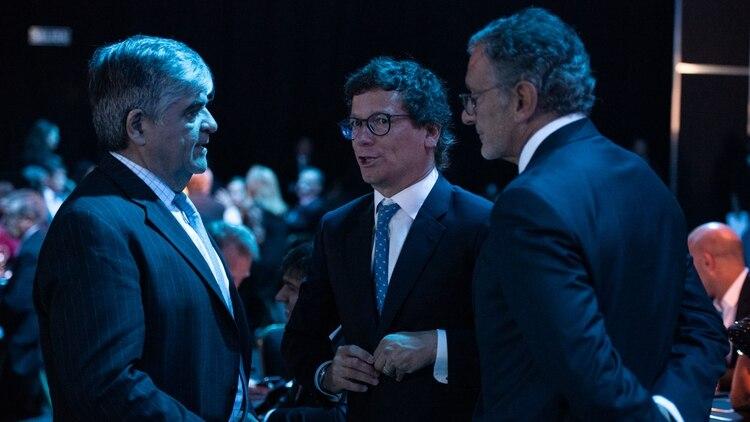 Miguel Gutiérrez, de YPF; Gabriel Martino de HSBC; y Claudio Cesario, de la Asociación de Bancos de la Argentina (Fotos: Adrián Escandar y Manuel Cortina)