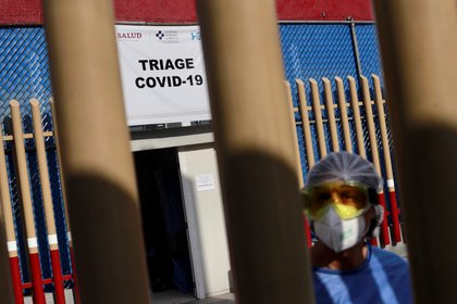 A health workers stands by the entrance of the triage for patients with COVID-19 as the coronavirus disease (COVID 19) continues in Mexico City, Mexico May 4 2020. REUTERS/Carlos Jasso