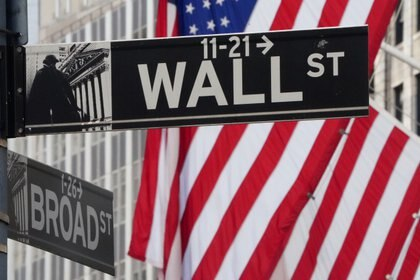 The Wall Street sign is pictured at the New York Stock exchange (NYSE) in the Manhattan borough of New York City, New York, U.S., March 9, 2020. REUTERS/Carlo Allegri