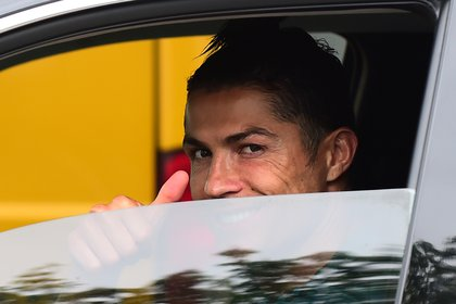 Juventus' Cristiano Ronaldo gestures as he leaves Juventus Training Center following the outbreak of the coronavirus disease (COVID-19), Turin, Italy, May 19, 2020. REUTERS/Massimo Pinca     TPX IMAGES OF THE DAY