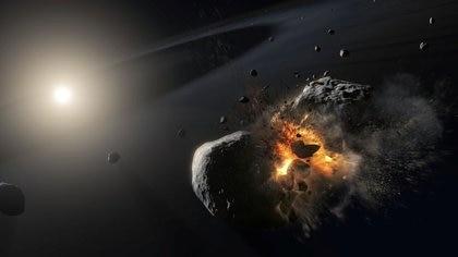 Impresión artística de la colisión de dos cuerpos helados del tamaño de un asteroide que orbitan alrededor de la brillante estrella Fomalhaut, a unos 25 años luz de la Tierra (ESA/ NASA/ M. Kornmesser/ Folleto vía Reuters)