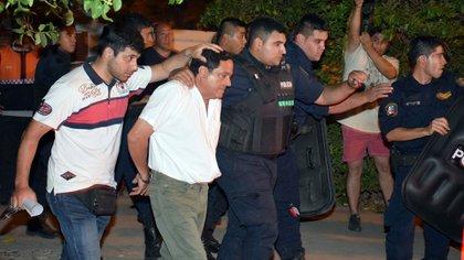 Miguel Ángel Jiménez, al ser detenido por la PFA. (Télam)