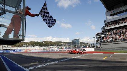 FILE PHOTO: Formula One F1 - Russian Grand Prix - Sochi Autodrom, Sochi, Russia - September 29, 2019 Ferrari's Charles Leclerc crosses the finish line. Yuri Kochetkov/Pool via REUTERS/File Photo