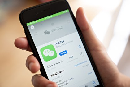 The WeChat app in the App Store on a smartphone. Photographer: Andrew Harrer/Bloomberg