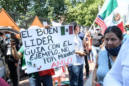 Supporters of Mexican President Andres Manuel Lopez Obrador gather near the White House in Washington, DC, on July 8, 2020 ahead of his meeting with US President Donald Trump. (Photo by NICHOLAS KAMM / AFP)