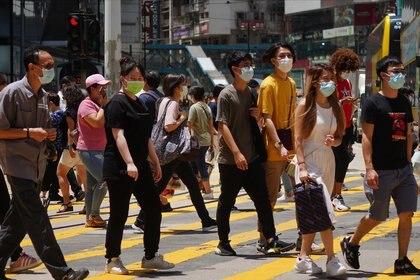 31/08/2020 Un grupo de personas camina por una de las calles del centro de Hong Kong. POLITICA JAPÓN ASIA ASIA HONG KONG CHINA ASIA INTERNACIONAL SAM TSANG / ZUMA PRESS / CONTACTOPHOTO