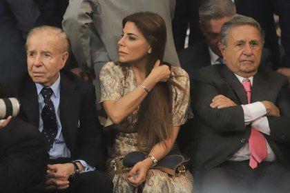 Los ex presidentes Carlos Menem y Eduardo Duhalde durante la ceremonia del traspaso de mando presidencial entre Mauricio Macri y Alberto Fernández en 2019