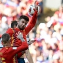 The ball hits Spain's defender Gerard Pique's hand in the penalty area during the Russia 2018 World Cup round of 16 football match between Spain and Russia at the Luzhniki Stadium in Moscow on July 1, 2018. / AFP PHOTO / Juan Mabromata / RESTRICTED TO EDITORIAL USE - NO MOBILE PUSH ALERTS/DOWNLOADS
