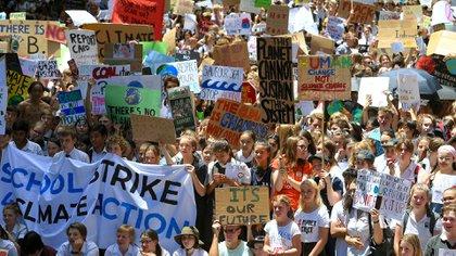Las protestas se organizaron a raíz de un informe de la ONU que indicaba que Australia no estaba cumpliendo con sus compromisos de cambio climático (EFE/ Dan Himbrechts)