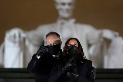 """Vice President of the United States, Kamala Harris, and her husband Doug Emhoff attend the event """"Celebrating America"""" at the Lincoln Memorial after Joe Biden's inauguration as the 46th President of the United States in Washington. REUTERS / Joshua Roberts / Pool"""