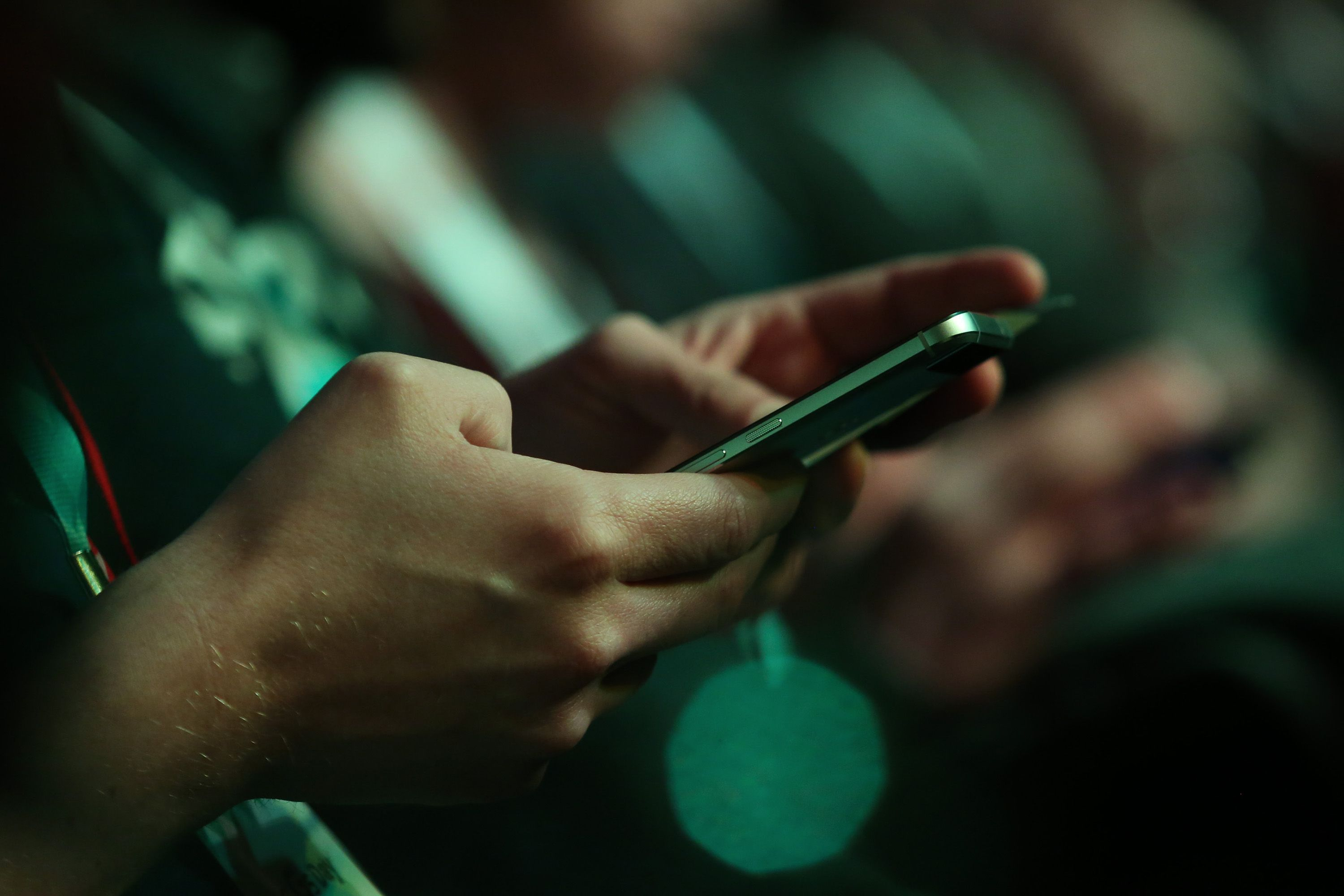 A man uses a mobile device.