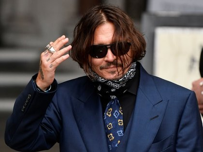 Actor Johnny Depp gestures as he arrives at the High Court in London, Britain, July 9, 2020. REUTERS/Toby Melville