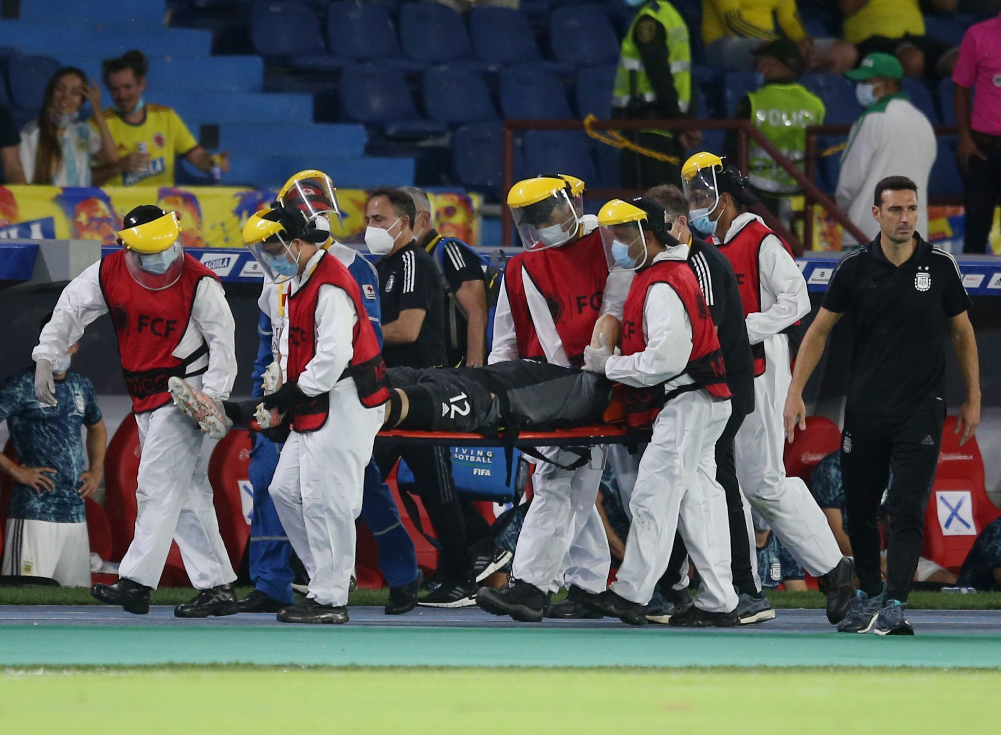 Soccer Football - World Cup - South American Qualifiers - Colombia v Argentina - Estadio Metropolitano, Barranquilla, Colombia - June 8, 2021 Argentina's Emiliano Martinez is stretchered off after sustaining an injury REUTERS/Luisa Gonzalez