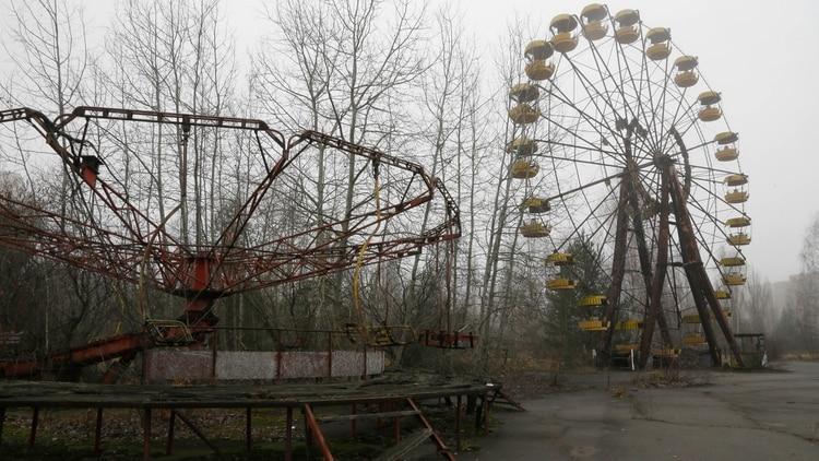 Un fantasmagórico parque de diversiones en la ciudad de Pripiat que quedó abandonado tras la tragedia (AP)