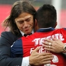 Chivas' coach Matias Almeyda embraces Edwin Hernandez as they celebrate their win over Tigres for the Mexican soccer league championship in Guadalajara, Mexico, Sunday, May 28, 2017. (AP Photo/Eduardo Verdugo)