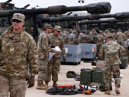 FILE PHOTO: U.S. troops from 2nd Armored Brigade Combat Team, 1st Armored Division check military equipment after their deployment to Poland for military exercises in Drawsko Pomorskie training area, Poland March 21, 2019.  REUTERS/Kacper Pempel/File Photo