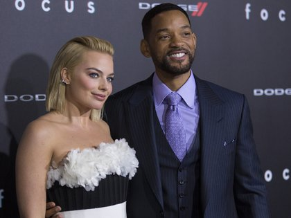 "Cast members Will Smith and Margot Robbie pose at the premiere of ""Focus"" at the TCL Chinese theatre in Hollywood, California February 24, 2015. The movie opens in the U.S. on February 27.   REUTERS/Mario Anzuoni  (UNITED STATES - Tags: ENTERTAINMENT)"