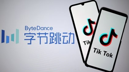 FILE PHOTO: TikTok logos are seen on smartphones in front of a displayed ByteDance logo in this illustration taken Nov. 27, 2019. REUTERS/Dado Ruvic/Illustration/File Photo
