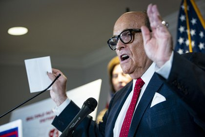 Rudy Giuliani, personal lawyer to U.S. President Donald Trump, speaks during a news conference at the Republican National Committee headquarters in Washington, D.C., U.S., on Thursday, Nov. 19, 2020. President Donald Trump's campaign revised a pivotal Pennsylvania lawsuit seeking to block certification of the state's election results, adding a proposal that the Republican-controlled state legislature choose the winner instead of voters.