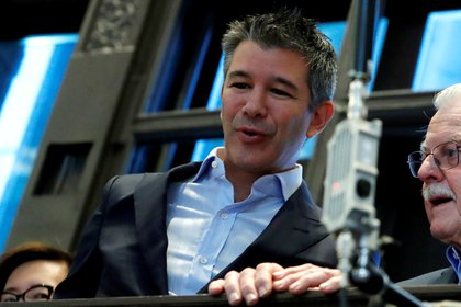 FILE PHOTO: Former Uber Technologies Inc. CEO and co-founder Travis Kalanick stands on a balcony above the trading floor of the New York Stock Exchange (NYSE) during the company's IPO in New York, U.S., May 10, 2019. REUTERS/Andrew Kelly/File Photo