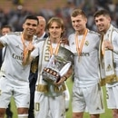 Soccer Football - Spanish Super Cup Final - Real Madrid v Atletico Madrid - King Abdullah Sports City, Jeddah, Saudi Arabia - January 12, 2020 Real Madrid's Luka Modric lifts the trophy as he celebrates winning the Super Cup with Casemiro, Toni Kroos and Federico Valverde REUTERS/Waleed Ali