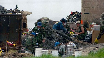 Investigators search for clues in the rubble of the destroyed Branch Davidian compound near Waco, Texas on Tuesday, April 27, 1993. Independent fire arson investigators announced Monday they have concluded the cultists themselves set the fire that destroyed the compound.Ron Heflin/AP