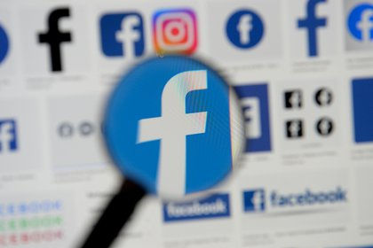 FILE PHOTO: Facebook logos are seen on a screen in this picture illustration taken December 2, 2019. REUTERS/Johanna Geron/Illustration/File Photo