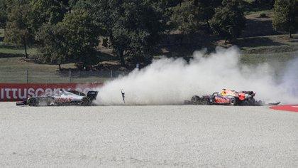 Formula One F1 - Tuscan Grand Prix - Mugello, Scarperia e San Piero, Italy - September 13, 2020 Haas' Romain Grosjean and Red Bull's Max Verstappen crash out at the start of the race Pool via REUTERS/Luca Bruno