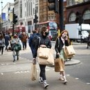 FILE PHOTO: People walk at Oxford Street, as the coronavirus disease (COVID-19) restrictions ease, in London, Britain April 12, 2021. REUTERS/Henry Nicholls/File Photo