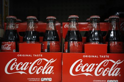 Bottles of Coca-Cola Co. soft drinks are displayed for sale at a store in Louisville, Kentucky, U.S., on Monday, Feb. 10, 2020. Coca-Cola rose after reporting better-than-expected revenue growth for the fourth quarter, citing rising demand overseas and higher demand for its low-sugar offerings in the U.S. Photographer: Luke Sharrett/Bloomberg
