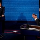 Democratic presidential candidate former Vice President Joe Biden answers a question as President Donald Trump listens during the second and final presidential debate at the Curb Event Center at Belmont University in Nashville, Tennessee, U.S., October 22, 2020. Morry Gash/Pool via REUTERS