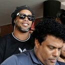 FILE PHOTO: Paraguay police question Ronaldinho over alleged 'adulterated' passport - Paraguayan Public Ministry, Asuncion, Paraguay - March 5, 2020 Ronaldinho leaves the Paraguayan Public Ministry where he testified along with his brother Roberto de Asis REUTERS/Jorge Adorno/File Photo
