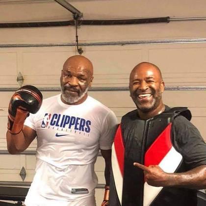 Mike Tyson junto al brasileño Rafael Cordeiro, su nuevo entrenador