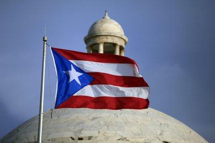 Los habitantes de este estado no incorporado son ciudadanos pero con derechos restringidos, como los de Guam, las Islas Vírgenes Estadounidenses o las Islas Marianas del Norte. (AP/Ricardo Arduengo)
